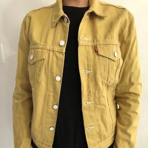 Yellow denim Levis jacket with white hardware